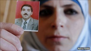 Photo of Dirar Abu Sisi held by his wife