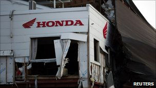 A Honda sign at a building damaged by the 11 March tsunami in Kesennuma town, Miyagi Prefecture