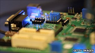 Semiconductors are seen on a circuit board that powers a Samsung video camera