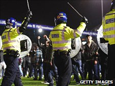 Birmingham fans run onto the pitch