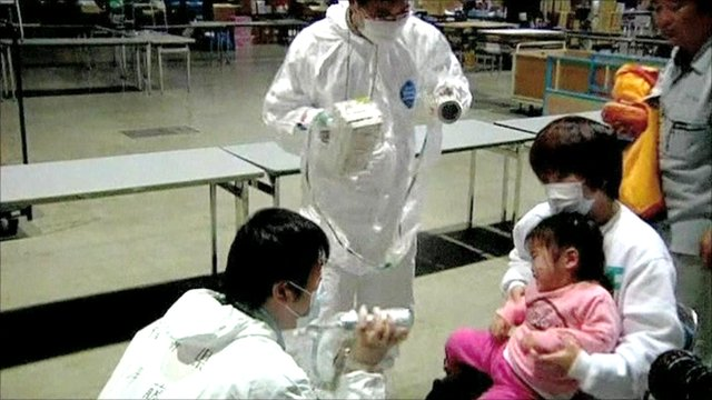 Japanese child checked for radiation level by medical workers