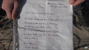 Daniil Korotkich shows the letter