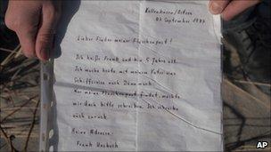Daniil Korotkich shows the letter