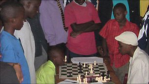 Benjamin Mukumbya (left) playing an opponent during the National Schools Chess Competition (picture courtesy of Robert Katende)