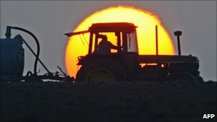 Tractor against a sunset