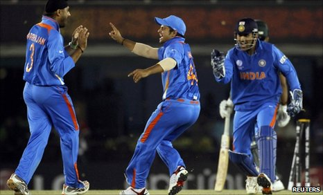 Harbhajan Singh claims the key wicket of Umar Akmal