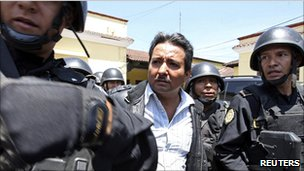 Drug suspect Juan Ortiz Lopez is escorted by police in Guatemala