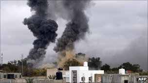 Smoke rises over Tripoli from coalition air strikes