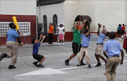 Maraval Primary pupils play cricket