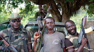 Pro-Ouattara forces are pictured with their weapons on 28 March 2011 in Blolequin, in western Ivory Coast