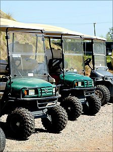 Golf buggies lined up at the E-Z-GO factory