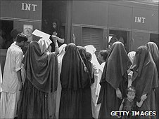 (File photo 1947) In New Delhi Muslim women prepare to board a train which is heading for Pakistan.