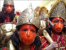 Indian Hindu devotees dressed as the God Hanuman participate in a religious procession