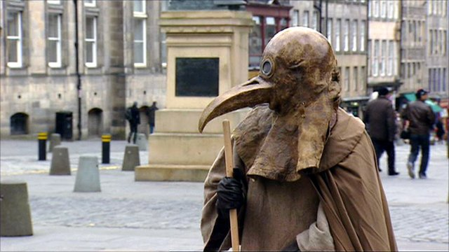Frank To dressed as a plague doctor