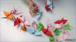Making origami cranes for the Senbazuru (a thousand cranes) campaign, with participants worldwide