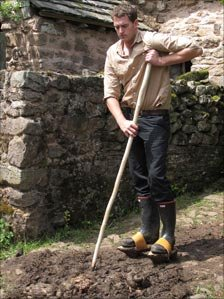Dan Snow in wooden overshoes, worn in medieval times to lift walkers above the filth on the streets