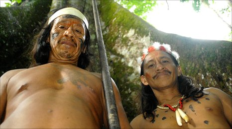 Two Huaorani men and blowpipe