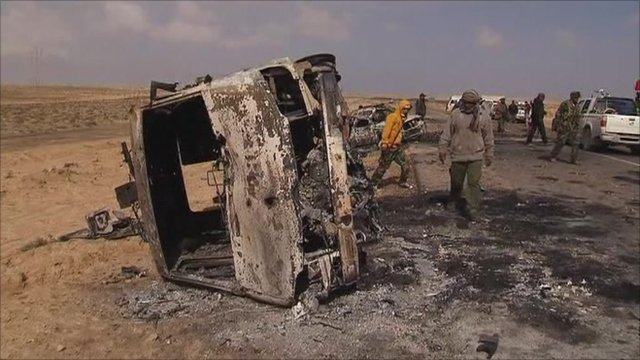 Burned out vehicles ten miles outside Ajdabiya