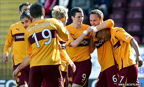 Chris Humphrey (right) is congratulated by his Motherwell team-mates