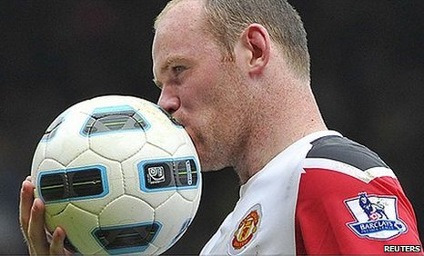 Man Utd striker Wayne Rooney grabbed a hat-trick against West Ham and gives the ball a kiss