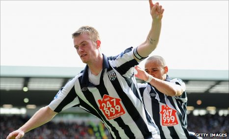 Chris Brunt celebrates scoring his second penalty against Liverpool