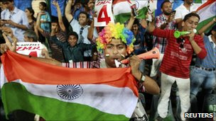 Fans celebrate as India secure a win over Sri Lanka in the cricket World Cup final - 02 April 2011