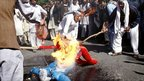 Afghan protesters burn an effigy of US President Barack Obama during a demonstration in Jalalabad, Afghanistan, 3 April 2011.