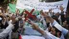 Afghan protesters shout anti-US slogans as one of them holds a cross during a demonstration in Jalalabad, 23 April 2011.
