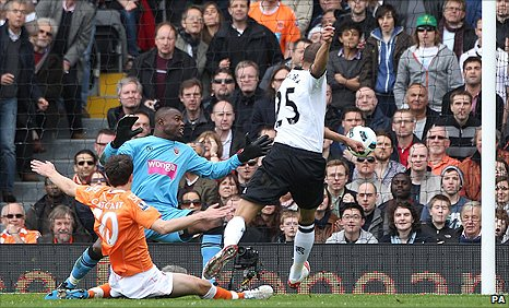 Fulham striker (right) powers in a shot for his opener against Blackpool