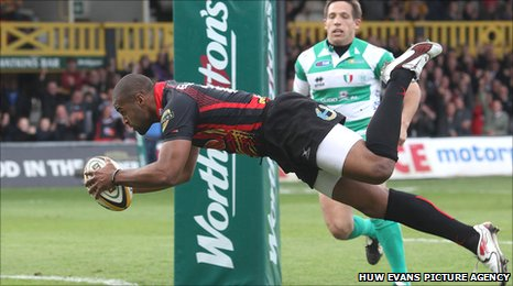 Dragons winger Aled Brew dives over for his first try against Treviso