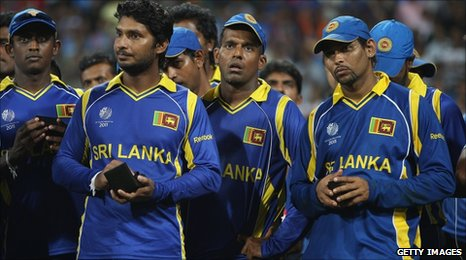 Tillakaratne Dilshan (right), captain Kumar Sangakkara and team-mates look dejected after the final