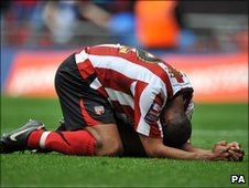 Brentford's Leon Legge kneels dejected after the final whistle