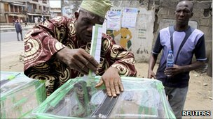 A man casts his vote before the postponement of the parliamentary election in Mushin neighbourhood in Nigeria's commercial centre Lagos April 2, 2011