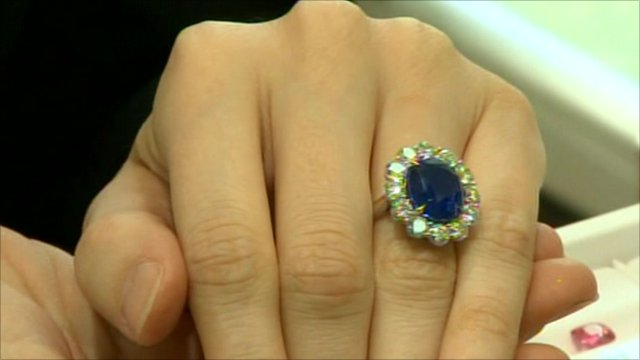 A diamond and sapphire ring