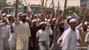 Islamic activists carrying sticks, during country-wide protests, Dhaka, April, 4, 2011