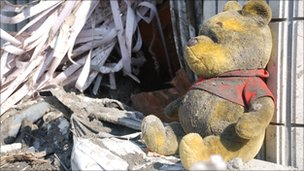 A discarded Winnie the Pooh sits amid debris left in the city of Otsuchi in north-eastern Japan