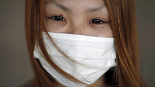 Woman outside Fukushima evacuation centre