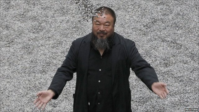 "Ai Weiwei with his installation ""Sunflower Seeds"" at the Tate Modern gallery in London (11 October 2010)"