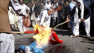 Afghan protesters burning an effigy of US President Barack Obama