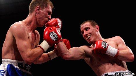 Ryan Walsh (right) lands a punch on Gavin Reid at London's York Hall