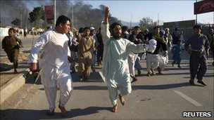 Afghan protesters marching and shouting anti-US slogans