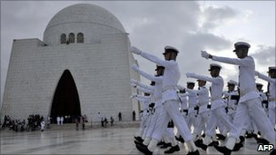 Naval cadets march past Pakistan's National Masoleum