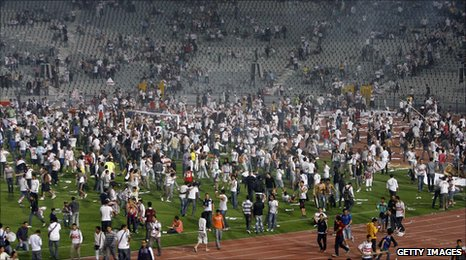 Zamalek fans flood the pitch at the Cairo International Stadium