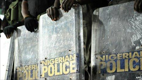 Nigerian police holding shields