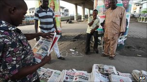 People reading newspaper in Lagos, Nigerian on Sunday 3 April 2011
