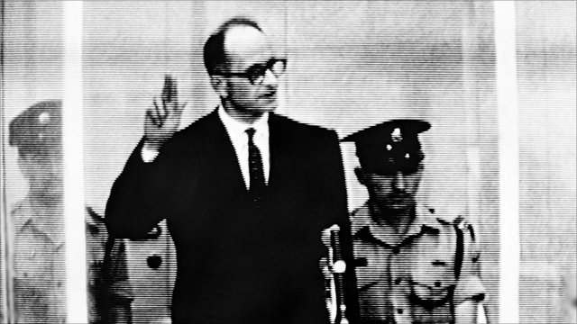 Adolf Eichmann taking the oath at the start of his trial in April 1961