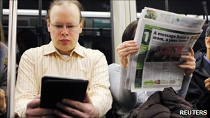 Commuters reading the news