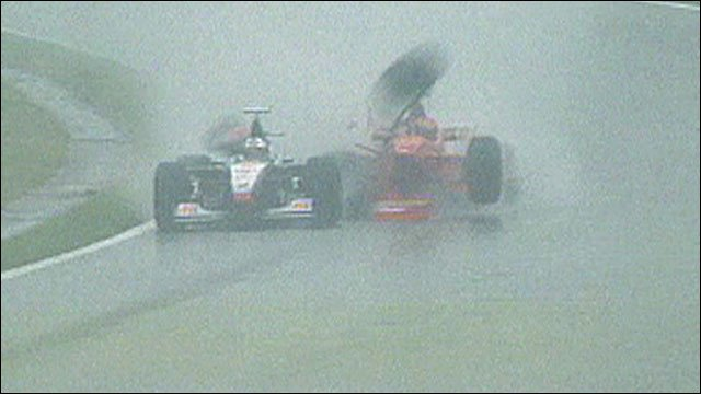 Michael Schumacher collides with David Coulthard