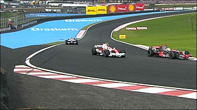 Lewis Hamilton gets past Timo Glock