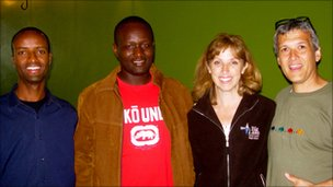 Carl Wilkens and his wife Teresa with some of the survivors of the genocide